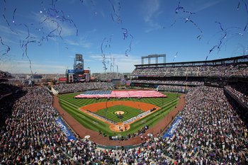 DENVER - APRIL 09:  Players and fans observe the national anthem as the stars and stripes is presented by members of the US military as the Colorado Rockies host the San Diego Padres during MLB action on Opening Day at Coors Field on April 9, 2010 in Denv