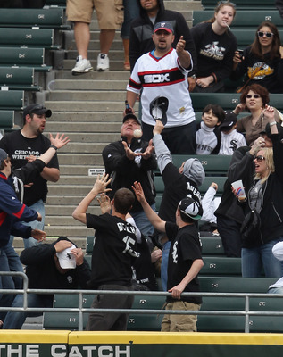 CHICAGO, IL - MAY 01: Fans of the Chicago White Sox scramble for a home run ball hit by Adam Dunn in the 8th inning against the Baltimore Orioles at U.S. Cellular Field on May 1, 2011 in Chicago, Illinois. The Orioles defeated the White Sox 6-4. (Photo by
