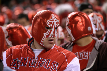 ANAHEIM, CA - MAY 10:  Fans wear wrestling masks given away as a promotion as they set a Guinness World Record for 'largest gathering of people wearing costume masks' during the game between the Chicago White Sox and the Los Angeles Angels of Anaheim on M