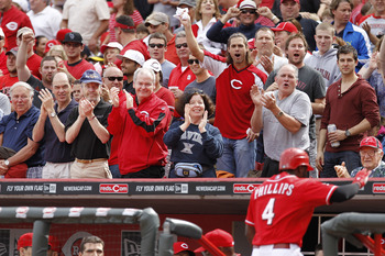 CINCINNATI, OH - MAY 14: Fans cheer as Brandon Phillips #4 of the Cincinnati Reds returns to the dugout after hitting a home run in the second inning against the St. Louis Cardinals at Great American Ball Park on May 14, 2011 in Cincinnati, Ohio. The Reds