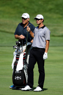 BETHESDA, MD - JUNE 13:  Adam Scott of Australia (R) pulls a club from his bag as his caddie Steve Williams (L) looks on during a practice round prior to the start of the 111th U.S. Open at Congressional Country Club on June 13, 2011 in Bethesda, Maryland