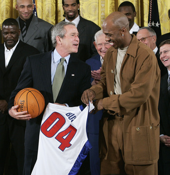 WASHINGTON - JANUARY 31: U.S President George W. Bush receives a jersey as a souvenir from Detroit Pistons player Chauncey Billups, during an East Room event at the White House January 31, 2005 in Washington, DC. President Bush hosted the Detroit Pistons