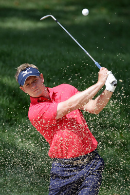 BETHESDA, MD - JUNE 14:  Luke Donald of England  plays a bunker shot during a practice round prior to the start of the 111th U.S. Open at Congressional Country Club on June 14, 2011 in Bethesda, Maryland.  (Photo by Ross Kinnaird/Getty Images)
