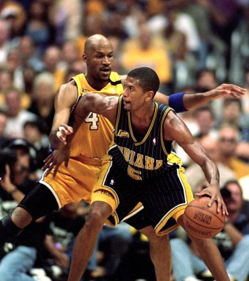 19 Jun 2000:  Jalen Rose #5 of the Indiana Pacers moves with the ball as Ron Harper #4 of the Los Angeles Lakers gaurds him during the NBA Finals Game 6 at the Staples Center in Los Angeles, California.  The Lakers defeated the Pacers in 116-111.  NOTE TO