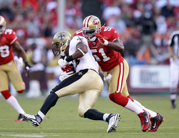 SAN FRANCISCO - SEPTEMBER 20:  Pierre Thomas #23 of the New Orleans Saints is tackled by Takeo Spikes #51 of the San Francisco 49ers at Candlestick Park on September 20, 2010 in San Francisco, California.  (Photo by Ezra Shaw/Getty Images)