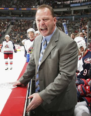 VANCOUVER - FEBRUARY 6: Columbus Blue Jackets head coach Gerard Gallant complains to the referee that Todd Bertuzzi of the Vancouver Canucks was playing with blood on his face durig their game at General Motors Place on February 6, 2006 in Vancouver, Cana