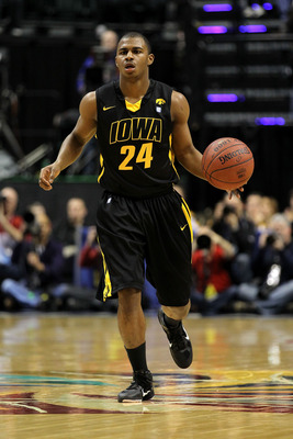 INDIANAPOLIS, IN - MARCH 10:  Bryce Cartwright #24 of the Iowa Hawkeyes brings the ball up court against the Michigan State Spartans during the first round of the 2011 Big Ten Men's Basketball Tournament at Conseco Fieldhouse on March 10, 2011 in Indianap