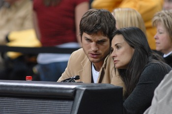 IOWA CITY, IA - DECEMBER 12:  Actors Ashton Kutcher and wife Demi Moore watch the second half of the game during the Iowa-Iowa State college basketball game on December 12, 2008 at the University of Iowa in Iowa City, Iowa. Johnson and Kutcher, both from