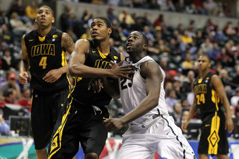 INDIANAPOLIS, IN - MARCH 10:  Draymond Green #23 of the Michigan State Spartans fights for rebound position against Melsahn Basabe #1 of the Iowa Hawkeyes during the first round of the 2011 Big Ten Men's Basketball Tournament at Conseco Fieldhouse on Marc