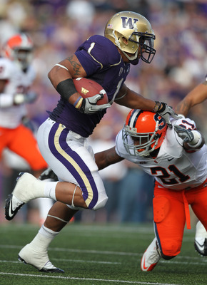 SEATTLE - SEPTEMBER 11:  Running back Chris Polk #1 of the Washington Huskies rushes against Shamarko Thomas #21 of the Syracuse Orange on September 11, 2010 at Husky Stadium in Seattle, Washington. (Photo by Otto Greule Jr/Getty Images)