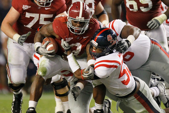 TUSCALOOSA, AL - OCTOBER 16:  Trent Richardson #3 of the Alabama Crimson Tide pushes for more yardage against Mike Marry #52 and Lawon Scott #96 of the Ole Miss Rebels at Bryant-Denny Stadium on October 16, 2010 in Tuscaloosa, Alabama.  (Photo by Kevin C.