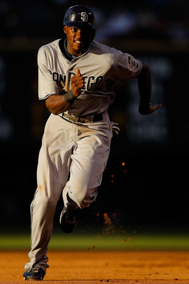 DENVER, CO - JUNE 14:  Cameron Maybin #24 of the San Diego Padres runs towards third base on his way to score on a double by teammate Alberto Gonzalez during the fourth inning at Coors Field on June 14, 2011 in Denver, Colorado. (Photo by Justin Edmonds/G