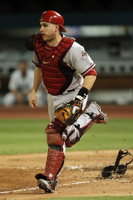 MIAMI GARDENS, FL - JUNE 10: Catcher Miguel Montero #26 of the Arizona Diamondbacks throws off his mask and heads down the baseline against the Florida Marlins at Sun Life Stadium on June 10, 2011 in Miami Gardens, Florida. (Photo by Eliot J. Schechter/Ge