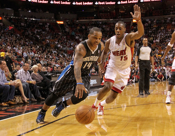 MIAMI, FL - MARCH 03:  Jameer Nelson #14 of the Orlando Magic drives around Mario Chalmers #15 of the Miami Heat during a game at American Airlines Arena on March 3, 2011 in Miami, Florida. NOTE TO USER: User expressly acknowledges and agrees that, by dow