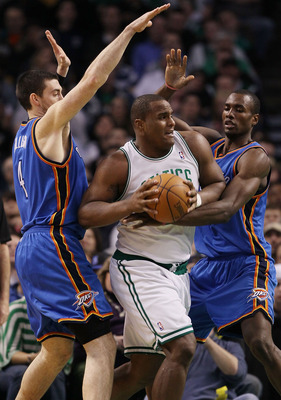 BOSTON - MARCH 31:  Glen Davis #11 of the Boston Celtics tries to break away from Nick Collison #4 and Serge Ibaka #9 of the Oklahoma City Thunder on March 31, 2010 at the TD Garden in Boston, Massachusetts. The Oklahoma City Thunder defeated the Boston C
