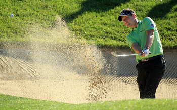 BETHESDA, MD - JUNE 15:  Luke Donald of England hits from a bunker during a practice round prior to the start of the 111th U.S. Open at Congressional Country Club on June 15, 2011 in Bethesda, Maryland.  (Photo by David Cannon/Getty Images)