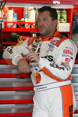 KANSAS CITY, KS - JUNE 03:  Tony Stewart, driver of the #14 The Glades/Office Depot Chevrolet, stands in the garage area during practice for the NASCAR Sprint Cup Series STP 400 at Kansas Speedway on June 3, 2011 in Kansas City, Kansas.  (Photo by Tim Ump