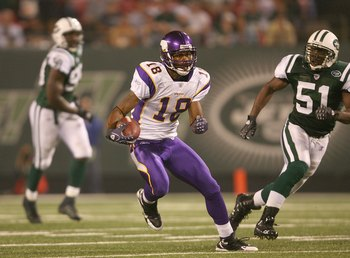 EAST RUTHERFORD, NJ - AUGUST 17:  Sidney Rice #18 of the Minnesota Vikings carries the ball against Jonathan Vilma #51 of the New York Jets during their preseason game on August 17, 2007 at Giants Stadium in East Rutherford, New Jersey. The Jets won 31-16