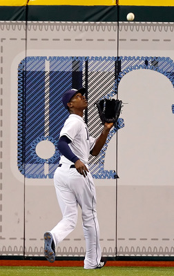 ST. PETERSBURG, FL - JUNE 15:  Outfielder B.J. Upton #2 of the Tampa Bay Rays catches a fly ball against the Boston Red Sox during the game at Tropicana Field on June 15, 2011 in St. Petersburg, Florida.  (Photo by J. Meric/Getty Images)