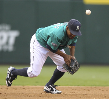 SEATTLE - JUNE 13:  Third baseman Chone Figgins #9 of the Seattle Mariners misplays this grounder by Jeff Mathis #5 of the Los Angeles Angels of Anaheim at Safeco Field on June 13, 2011 in Seattle, Washington. Figgins was charged with an error on the play