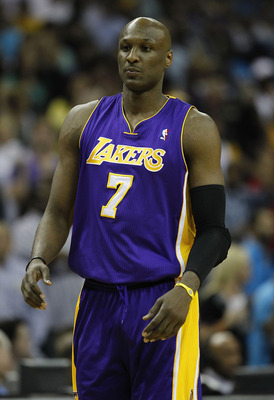 NEW ORLEANS, LA - APRIL 24:  Lamar Odom #7 of the Los Angeles Lakers stands during a freethrow against the New Orleans Hornets in Game Four of the Western Conference Quarterfinals in the 2011 NBA Playoffs at New Orleans Arena on April 24, 2011 in New Orle