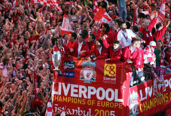 LIVERPOOL, ENGLAND - MAY 26:  The Liverpool team rides on an open top bus through a mass of fans as they arrive at St. George's Hall during the Liverpool Champions League Victory Parade on May 26, 2005 in Liverpool, England. Over 250,000 cheering fans hav