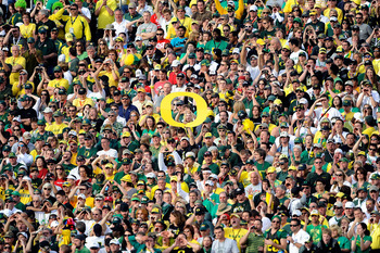PASADENA, CA - JANUARY 01:  A view of fans of the Oregon Ducks during the 96th Rose Bowl game against the Ohio State Buckeyes on January 1, 2010 in Pasadena, California.  (Photo by Kevork Djansezian/Getty Images)