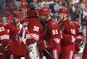 GLENDALE, AZ - APRIL 20:  Ed Jovanovski #55 of the Phoenix Coyotes talks with goaltender Ilya Bryzgalov #30 after being defeated by the Detroit Red Wings in Game Four of the Western Conference Quarterfinals during the 2011 NHL Stanley Cup Playoffs at Jobi