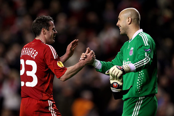 LIVERPOOL, ENGLAND - MARCH 18:  Pepe Reina of Liverpool celebrates with team mate Jamie Carragher (L) at the end of the UEFA Europa League Round of 16, second leg match at Anfield on March 18, 2010 in Liverpool, England.  (Photo by Alex Livesey/Getty Imag