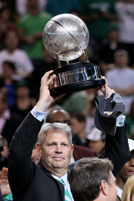 BOSTON - MAY 28:  Team president Danny Ainge of the Boston Celtics celebrates with the Eastern COnference trophy after the Celtics won 96-84 against the Orlando Magic in Game Six of the Eastern Conference Finals during the 2010 NBA Playoffs at TD Garden o