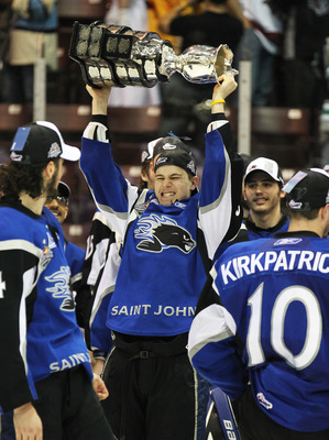 MISSISSAUGA, CANADA - MAY 29: Nathan Beaulieu #28 of the Saint John Sea Dogs celebrates with the Memorial Cup after the win against the Mississauga St. Michael's Majors in the 2011 CHL Mastercard Memorial Cup final on May 29, 2011 at the Hershey Centre in