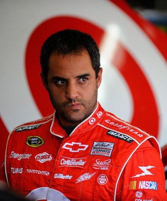 CHARLOTTE, NC - MAY 26:  Juan Pablo Montoya, driver of the #42 Target Chevrolet, stands in the garage during practice for the NASCAR Sprint Cup Series Coca-Cola 600 at Charlotte Motor Speedway on May 26, 2011 in Charlotte, North Carolina.  (Photo by Jared