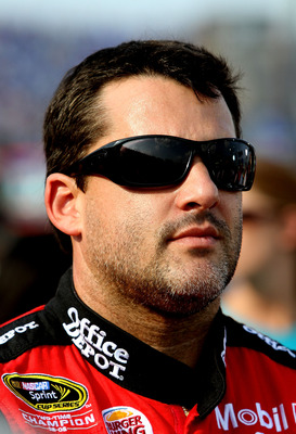 CONCORD, NC - MAY 29:  Tony Stewart, driver of the #14 Office Depot/Mobil 1 Chevrolet, stands on the grid prior to the NASCAR Sprint Cup Series Coca-Cola 600 at Charlotte Motor Speedway on May 29, 2011 in Concord, North Carolina.  (Photo by Jerry Markland