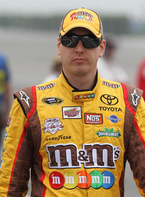 LONG POND, PA - JUNE 11:  Kyle Busch, driver of the #18 M&M's Toyota, looks on during qualifying for the NASCAR Sprint Cup Series 5-Hour Energy 500 at Pocono Raceway on June 11, 2011 in Long Pond, Pennsylvania.  (Photo by Jerry Markland/Getty Images for N