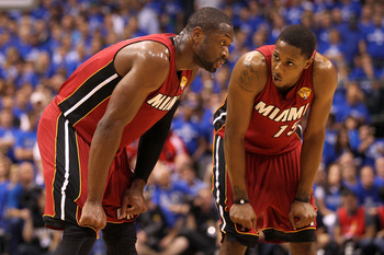 DALLAS, TX - JUNE 07:  Dwyane Wade #3 (L) and Mario Chalmers #15 of the Miami Heat talk on court against the Dallas Mavericks in Game Four of the 2011 NBA Finals at American Airlines Center on June 7, 2011 in Dallas, Texas. NOTE TO USER: User expressly ac