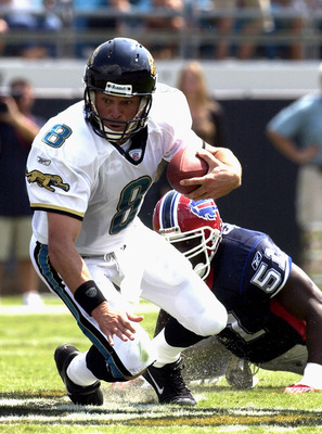 Jacksonville Jaguars quarterback Mark Brunell scrambles against the Buffalo Bills pass rush  Sunday, September 14, 2003 at Alltel Stadium, Jacksonville.  The Bills defeated the Jaguars 38 - 17.  (Photo by Al Messerschmidt/Getty Images)