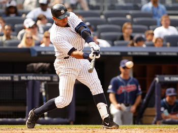 NEW YORK - JUNE 12:  Alex Rodriguez #13 of the New York Yankees hits an RBI single against the Cleveland Indians in the bottom of the eight inning on June 12, 2011 at Yankee Stadium in the Bronx borough of New York City. The Yankees defeated the Indians 9