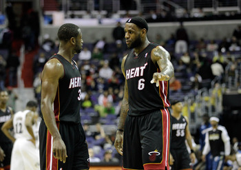WASHINGTON, DC - MARCH 30:  Dwyane Wade #3 of the Miami Heat and LeBron James #6 talk during their game against the Washington Wizards at the Verizon Center on March 30, 2011 in Washington, DC. NOTE TO USER: User expressly acknowledges and agrees that, by