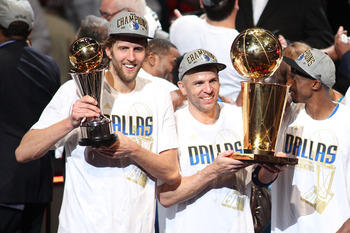 MIAMI, FL - JUNE 12:  (L-R) Finals MVP Dirk Nowitzki #41, Jason Kidd #2 and Jason Terry #31 of the Dallas Mavericks celebrate with the Larry O'Brien trophy after they won 105-95 against the Miami Heat in Game Six of the 2011 NBA Finals at American Airline