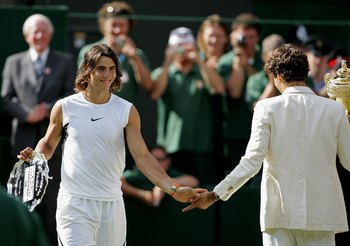 LONDON - JULY 09:  Roger Federer (R) of Switzerland and Rafael Nadal of Spain shake hands after the men's final on day thirteen of the Wimbledon Lawn Tennis Championships at the All England Lawn Tennis and Croquet Club on July 9, 2006 in London, England.