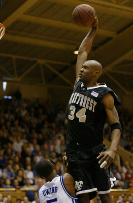 19 Jan 2002:  Antwan Scott #34 of Wake Forest dunks over Daniel Ewing #5 during the first half of the Wake Forest Demon Deacons v Duke Blue Devils game at Cameron Indoor Stadium in Durham, North Carolina.  Digital Image. Mandatory Credit: Craig Jones/Gett