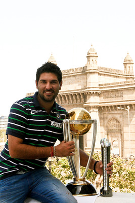 MUMBAI, INDIA - APRIL 03:  Yuvraj Singh of the Indian cricket team poses with the  ICC Cricket World Cup Trophy, with the Gateway of India in the backdrop, during a photo call at the Taj Palace Hotel on April 3, 2011 in Mumbai, India.  (Photo by Ritam Ban
