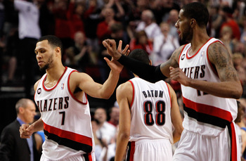 PORTLAND, OR - APRIL 23:  Brandon Roy #7 high fives LaMarcus Aldridge #12 of the Portland Trail Blazers against the Dallas Mavericks in Game Four of the Western Conference Quarterfinals in the 2011 NBA Playoffs on April 23, 2011 at the Rose Garden in Port