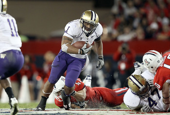 TUCSON, AZ - OCTOBER 23:  Runningback Chris Polk #1 of the Washington Huskies rushes the football during the college football game against the Arizona Wildcats at Arizona Stadium on October 23, 2010 in Tucson, Arizona. The Wildcats defeated the Huskies 44