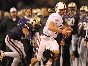 SEATTLE - OCTOBER 30:  Quarterback Andrew Luck #12 of the Stanford Cardinal rushes against Hau'oli Jamora #52 of the Washington Huskies on October 30, 2010 at Husky Stadium in Seattle, Washington. Stanford defeated Washington 41-0. (Photo by Otto Greule J