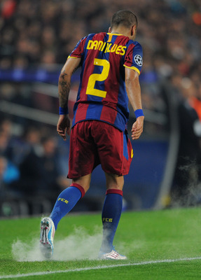 BARCELONA, SPAIN - APRIL 06:  Daniel Alves of Barcelona walks off after getting his ankle sprayed during the UEFA Champions League quarter final first leg match between Barcelona and Shakhtar Donetsk at the Camp Nou stadium on April 6, 2011 in Barcelona,