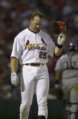 17 Sept 2001: First baseman Mark McGwire #25  throws his helmet during the game between the Cardinals and the Brewers at Busch stadium in St. Louis, Missouri.  The Cardinals defeated the Brewers 2-1.  DIGITAL IMAGE. Mandatory Credit: Elsa/ALLSPORT
