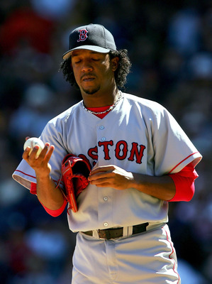 NEW YORK - SEPTEMBER 19:  Starting pictcher Pedro Martinez #45 of the Boston Red Sox closes his eyes after giving up a home run to Derek Jeter #2 the New York Yankees in the third inning on September 19, 2004 at Yankee Stadium in the Bronx, New York. The