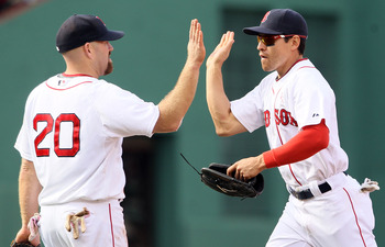 BOSTON, MA - MAY 08:  Kevin Youkilis #20 and Jacoby Ellsbury #2 of the Boston Red Sox celebrate the win over the Minnesota Twins on May 8, 2011 at Fenway Park in Boston, Massachusetts. The Boston Red Sox defeated the Minnesota Twins 9-5.  (Photo by Elsa/G