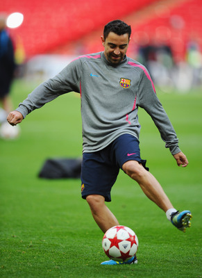 LONDON, ENGLAND - MAY 27:  Xavi of FC Barcelona controls the ball during a Barcelona training session prior to the UEFA Champions League final versus Manchester United at Wembley Stadium on May 27, 2011 in London, England.  (Photo by Clive Mason/Getty Ima